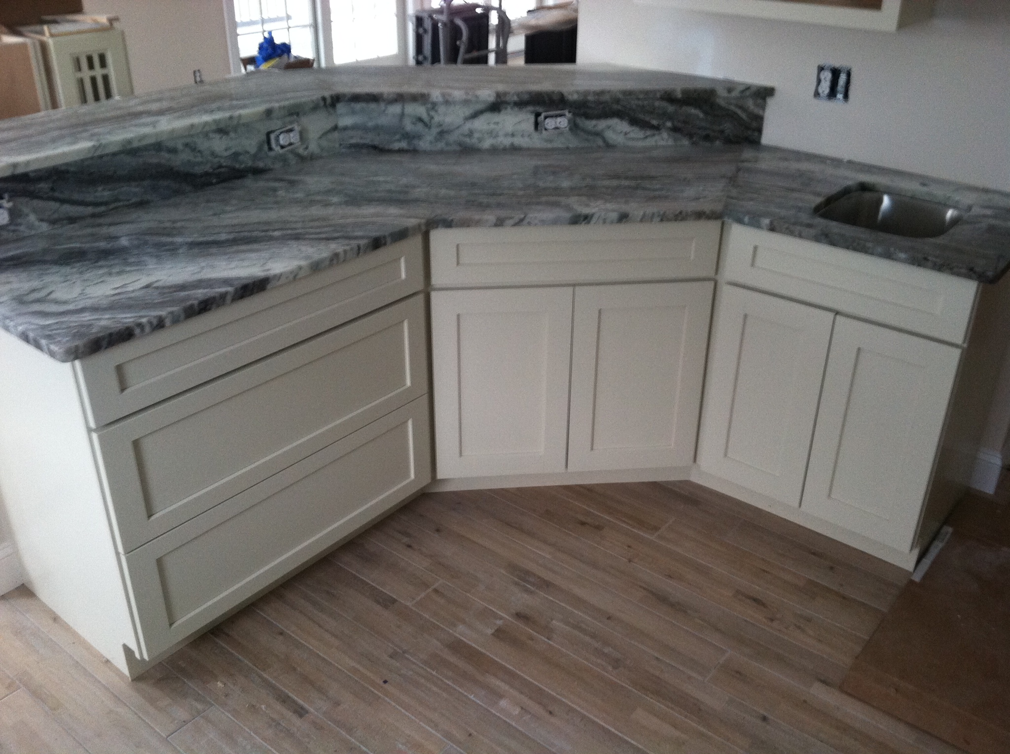 2014 01 25 view of granite brown fantasy peninsula lewes for Granite countertop width